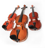 Three violins stock photos