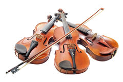 Three violins. Beautiful three violins isolated on a white background stock photography
