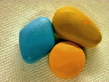 Three virility pills. Close-up of three coloured virility pills of different manufacturer on white background Stock Photography