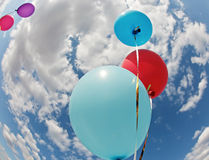 Three vivid color balloons in blue sky. Three vivid color balloons on blue sky background Royalty Free Stock Image
