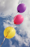 Three vivid color balloons on blue sky background. Three vivid color balloons flying on blue sky background stock images