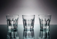 Three vodka glasses at mirror Royalty Free Stock Photography
