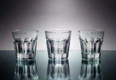 Three vodka glasses at mirror Royalty Free Stock Photography