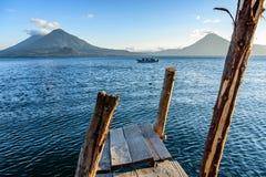 Three volcanoes & boat, Lake Atitlan, Guatemala Royalty Free Stock Photos