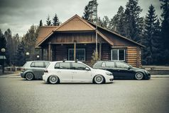 Three volkswagen golf 6 stance culture on air suspension lowride royalty free stock photography