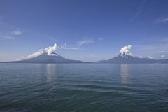 Three volvanoes. Panorama of the three volcanoes that surround Lake Atitlan, Guatemala Stock Image