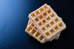 Three waffles on black table Stock Image