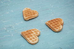 Three waffles on a blue background Stock Photography