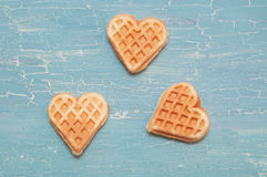 Three waffles on a blue background Royalty Free Stock Photos