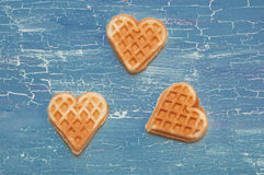 Three waffles on a blue background Stock Photos