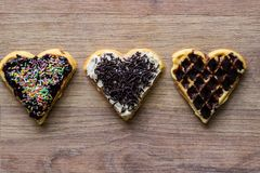 Three waffles with candy and chocolate Royalty Free Stock Image