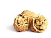 Three walnuts. On white background royalty free stock image