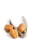 Three walnuts and nutcracker Royalty Free Stock Image