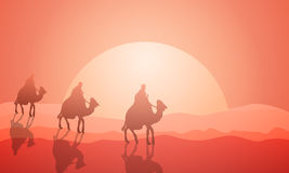 Three wanderers on camels in the desert Stock Image