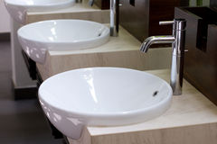 Three of wash basins and faucets Royalty Free Stock Photos