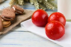 Three washed cherry tomatoes on paper sheet Royalty Free Stock Image