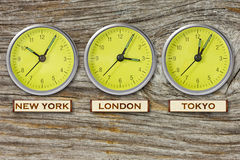 Three watches on wooden wall Stock Photos