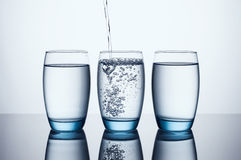 Three Water Glasses Stock Photos