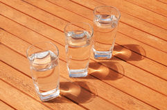 Three water glasses in a row Stock Photo