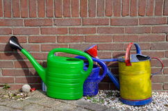Three watering cans Royalty Free Stock Images