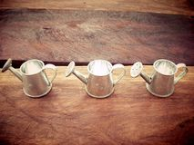 Three watering cans Stock Image