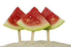 Three watermelons on sand beach Stock Photo