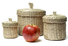 Three wattled baskets and apple isolated Stock Photography