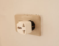 Three ways adapter installed wall Stock Image