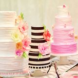 Three wedding cakes on a dessert table Royalty Free Stock Photo