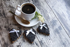 Three Wedding Cookies Decorated Black Sesame With A Cup Of Coffee. Retro Style. Stock Image