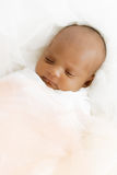 Three weeks old baby sleeping on white blanket cute infant newborn lying down close up shot eyes closed Royalty Free Stock Images