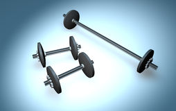 Three weights. Two small ones and a large one Royalty Free Stock Image