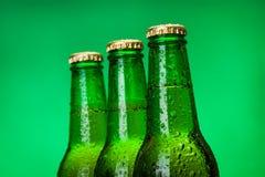 Three wet blank beer bottles Stock Images
