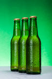 Three wet blank beer bottles Royalty Free Stock Photography