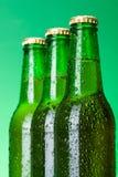 Three wet blank beer bottles Royalty Free Stock Photo
