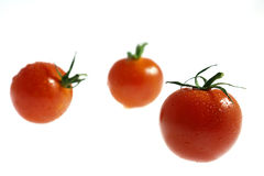 Three Wet Cherry Tomatos Stock Photo