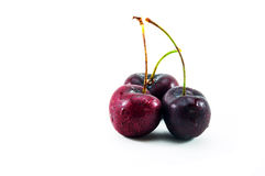 Three wet sweet cherries Royalty Free Stock Photos