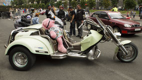 Three-wheeled bike with shiny chrome accents. Bikes on biker-show in Kiev on Constitution Day June 28, 2015 royalty free stock photo