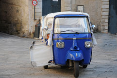 Three wheeled buggy. Three wheeled transportaion cab for sightseeing in Ostuni, Puglia, Italy Royalty Free Stock Images