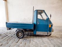 Three wheeled commercial vehicle, Italy. Piaggio Ape car, parked. Popular for agricultural use stock photography