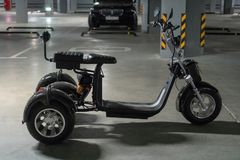 Three-wheeled electric motorcycle on the underground parking. stock photo