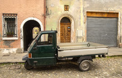 Three-wheeled light commercial vehicle. Tricycle, on the street in Italy royalty free stock image