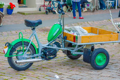 Three wheeled motorcyle in Marstrand, Sweden. MARSTRAND, SWEDEN - JUNE 21, 2015: Cute old three wheeled motorcyle in Marstrand, Sweden Stock Photography