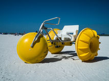 Three Wheeled Paddle or Petal Boat for Rent. A bright yellow three wheeled Pedal Boats or watercraft for rent on Fort Myers Beach Florida Royalty Free Stock Image
