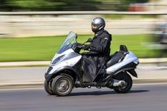 Three wheeled scooter Stock Photos