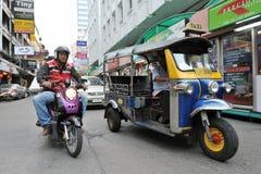 A Three-Wheeled Tuk Tuk Taxi on a Bangkok Street Stock Photos