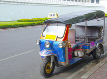 A three wheeled tuk tuk taxi on a street in Bangkok. A three wheeled or tuk tuk taxi on a street in Bangkok Stock Photography