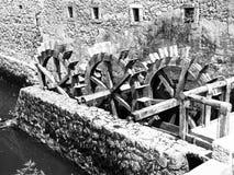 Three wheeled wooden mill Stock Photos