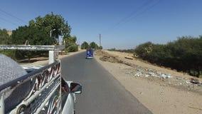 Three wheeler pickup transporting barrels. ASWAN, EGYPT - FEBRUARY 7, 2016: Three wheeler pickup transporting barrels stock footage