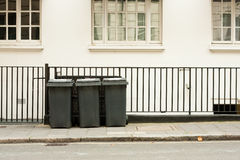 Three wheelie bins Stock Photography